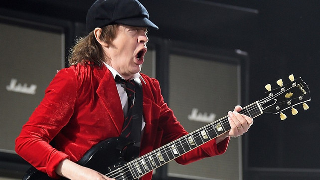 ULTIMATE GUITAR: AC/DC's Angus Young Explains Who Got Him to Wear Schoolboy Uniform Onstage, Clarifies if Bon Scott Contributed to 'Back in Black'
